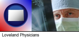 Loveland, Colorado - a physician viewing x-ray results