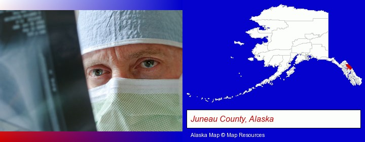 a physician viewing x-ray results; Juneau County, Alaska highlighted in red on a map